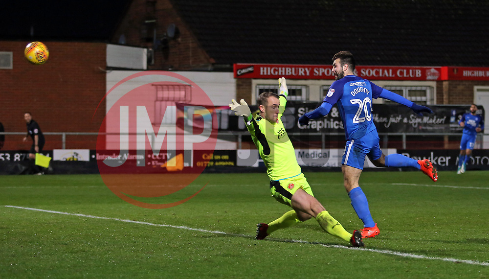 Michael Doughty of Peterborough United heads past Alex Cairns of Fleetwood Town to make the score 1-1 - Mandatory by-line: Joe Dent/JMP - 17/12/2017 - FOOTBALL - Highbury Stadium - Fleetwood, England - Fleetwood Town v Peterborough United - Sky Bet League One