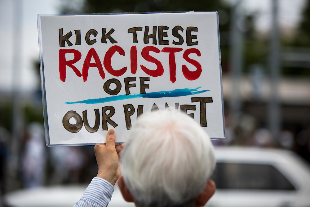 KAWASAKI, JAPAN - JUNE 05: A anti-racist man holding a placards as some fascist and racist groups clash with anti-fascist and anti-racist as they try to disrupt an Counter-Racist protest in Nakahara Peace Park, Kawasaki City, Kanagawa prefecture, Japan on June 5, 2016. A district court in Kanagawa Prefecture has issued a first-ever provisional injunction preventing an anti-Korean activist from holding a rally near the premises of a group that supports ethnic Korean people.<br /> <br /> Photo: Richard Atrero de Guzman