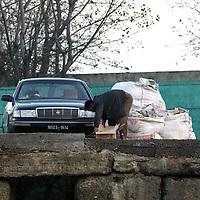SHINIUJU, OCTOBER-26: a man unloads goods next to a car  in the China-bound port  in Shiniuju,October 26,2006.