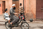 A young student get a ride to school through the medina.