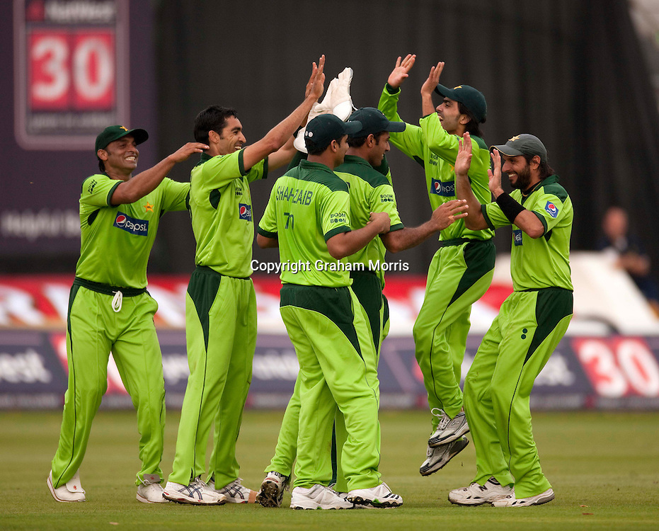 Celebrations as Steven Davies is out to Umar Gul (bareheaded) during the first T20 international between England and Pakistan in Cardiff.  Photo: Graham Morris (Tel: +44(0)20 8969 4192 Email: sales@cricketpix.com) 05/09/10