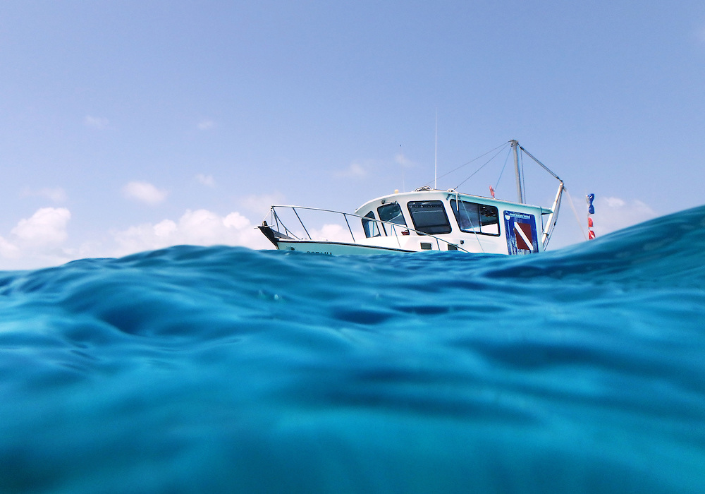 The view from the water of a dive boat bouncing on the waves in the Caribbean.