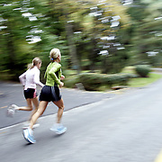 Rye, NY / 2007 - Local triathletes E.A. Dugan, 44, right, and Cassie McWilliam, 41, both of Rye, run roads in the Town of Rye October 24, 2007 as part of a training regimen for an upcoming event.  Dugan, a divorced mother of 3 boys, and McWilliam, a married mother of 2 children, constantly juggle training commitments while raising their children. (Mike Roy / The Journal News)