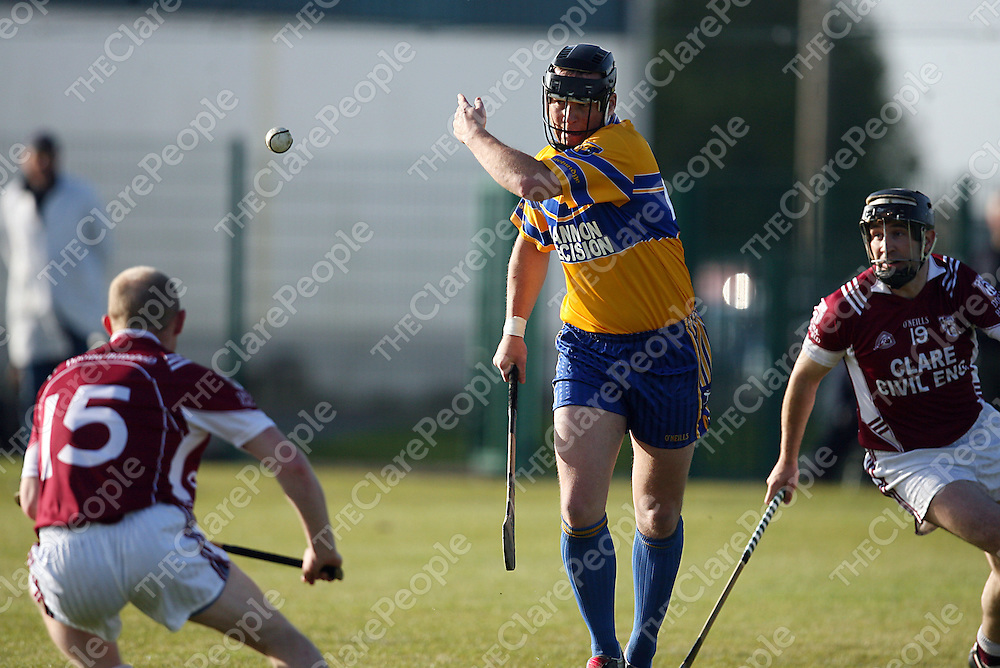 Sixmilebridge's Mark Culbert gets through Doora/Barefield's Colm Mullen and Seanie McMahon during their game in Clarecastle on Friday evening.<br /> Photograph by Yvonne Vaughan