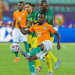 Jean Michael Seri of Ivory Coast clears ahead of Thamsanqa Mkhize of South Africa during the 2019 Africa Cup of Nations Finals game between Ivory Coast and South Africa at Al Salam Stadium in Cairo, Egypt on 24 June 2019  <br /> Photo : Icon Sport