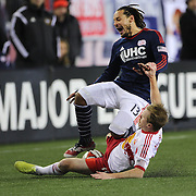 Jermaine Jones, New England Revolution, is fouled by Dax McCarty, New York Red Bulls, during the New England Revolution Vs New York Red Bulls, MLS Eastern Conference Final, second leg. Gillette Stadium, Foxborough, Massachusetts, USA. 29th November 2014. Photo Tim Clayton