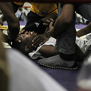 Mcede Bakhe lies on the ring's floor after being knocked out by his opponent during an amateur boxing tournament in Cosmo City, Johannesburg.