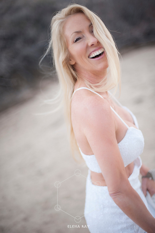 Gorgeous mature woman  in a beautiful white dress smiling in the desert. Kim Tang, Bikram yoga teacher in Johsua Tree, CA