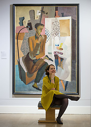 Curator of the exhibition Alice Strang recreates the pose in William Crosby's 'womb from womb' painting at the launch of the Scottish National Gallery of Modern Art major exhibition 'A New Era: Scottish Modern Art 1900-1950'<br /> <br /> © Dave Johnston/ EEm