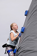 Gracie Morrison of Waynesville, Missouri closes in on the top of the climbing mountain during the Air Force Materiel Command's seventh annual Freedom's Call Tattoo at Wright-Patterson Air Force Base in Riverside, Friday, June 24, 2011.  Morrison is visiting her grandparents in New Carlisle.