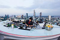 A bartender mixes cocktails at Chill Bar in Ho Chi Minh City, Vietnam.