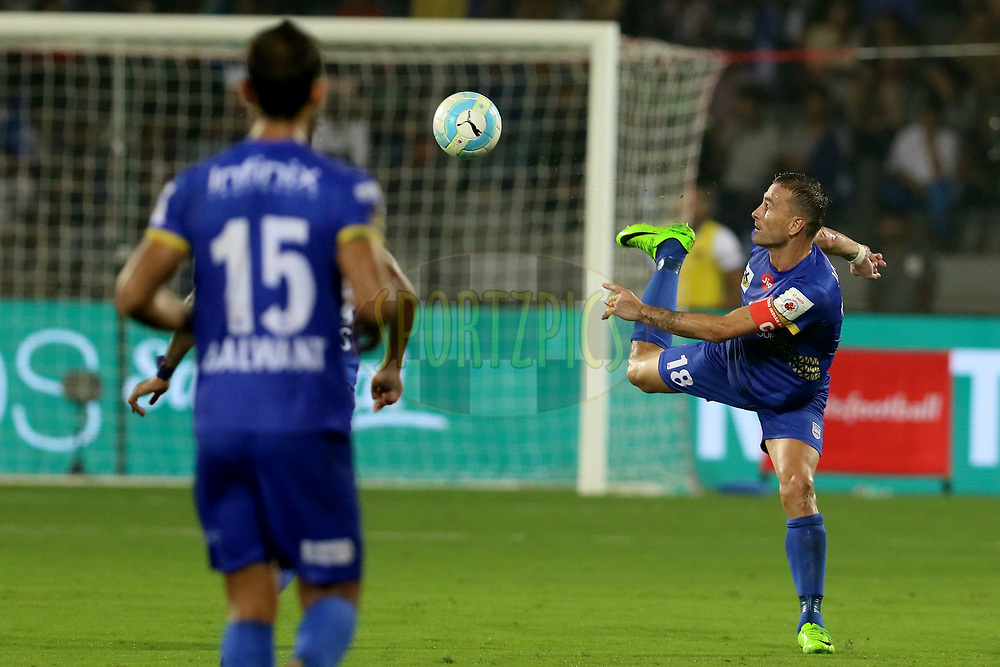 Lucian Goian of Mumbai City FC kicks the ball during match 22 of the Hero Indian Super League between Mumbai City FC and Chennaiyin FC  held at the Mumbai Football Arena, Mumbai India on the 10th December 2017<br /> <br /> Photo by: Vipin Pawar  / ISL / SPORTZPICS