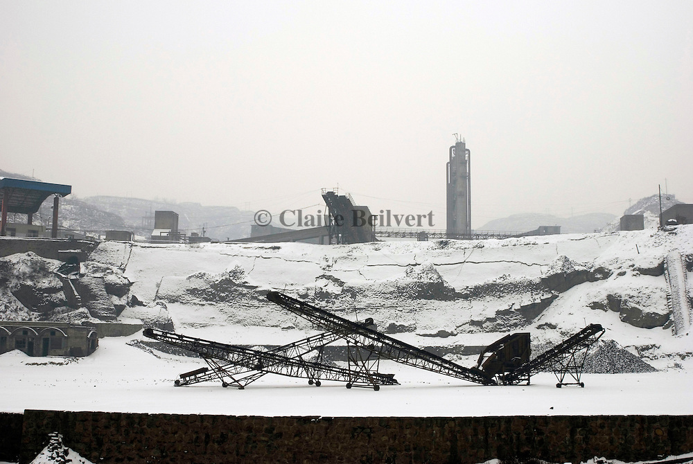 Iron mine. Shanxi is a mining area. Coal or iron mines. Thousands of miners are working here. Mining industry is one of the most dangerous for workers. Each year miners die of accidents and lack of security.