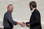 """13th Biennale of Architecture..Giardini..Austrian Pavillion..Wolfgang Tschapeller, Rens Veltman, Martin Perktold, """"hands have no tears to flow..."""", 2012..Opening ceremony..From l.: Comissioner Arno Ritter, Secretary of State Josef Ostermayer."""