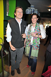 DOMINIC & TERESA DINAN at a party to celebrate the publication of Joth Shakerley's book 'Pregnant Women' held at 598a Kings Road, London SW6 on 20th May 2009.
