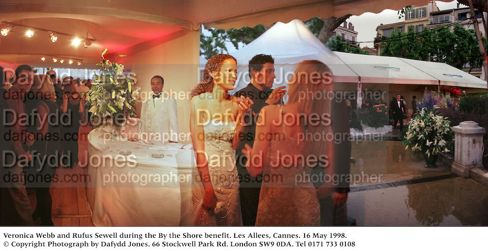 Veronica Webb and Rufus Sewell during the By the Shore benefit. Les Allees, Cannes. 16 May 1998. © Copyright Photograph by Dafydd Jones<br /> 66 Stockwell Park Rd. London SW9 0DA<br /> Tel 0171 733 0108