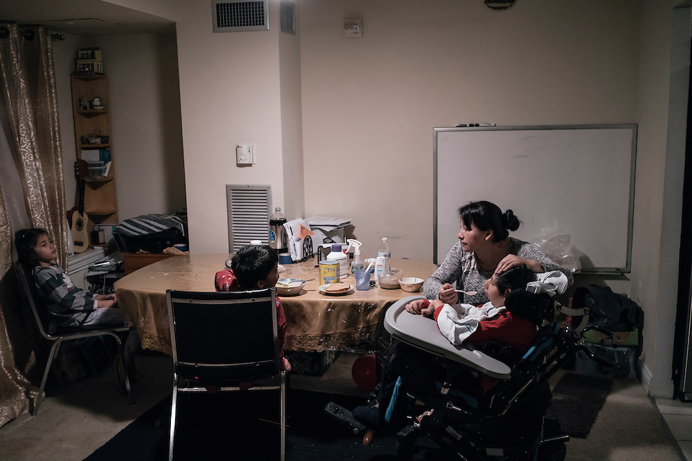 Eufronia Alba feeds and readies her son, Joshua, 10, for school at her apartment in Arlington, Va. on Dec. 15, 2016. Alba and her husband, undocumented Bolivians, were in deportation proceedings but have requested cancellation of removal because Joshua, who is American-born, has cerebal palsy and depends on his parents for everything including bathing and feeding. CREDIT: Greg Kahn / GRAIN for the Wall Street Journal TRUMPLOOP