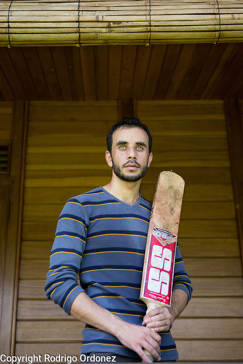 Sajid Ali, 23, stands for a photograph in Bogor, near Jakarta, Indonesia, on January 7, 2015. (Photo: Rodrigo Ordonez)<br /> Asylum seekers and refugees from Afghanistan and Pakistan have found solace in playing cricket as they wait for the review of their applications, which may take years. Many thought their stay in Asia would be a temporary transit before being resettled to other countries, such as Australia.