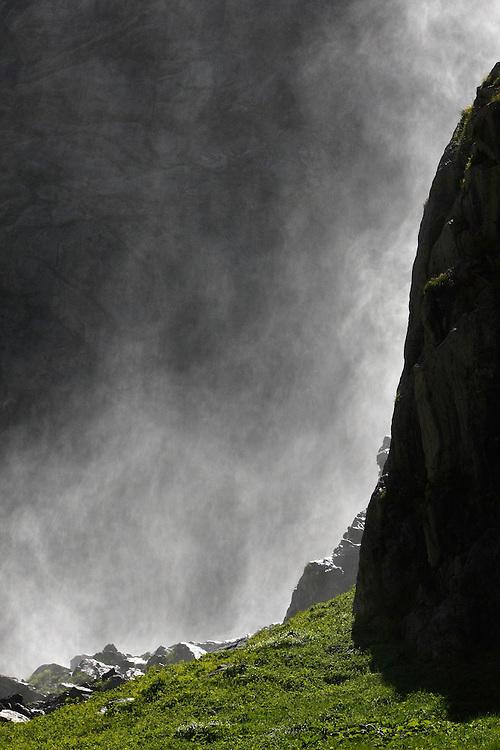 Russia, Caucasus, Teberdinsky biosphere reserve. Water spray from a waterfall in Amanauz Valley near Dombay.