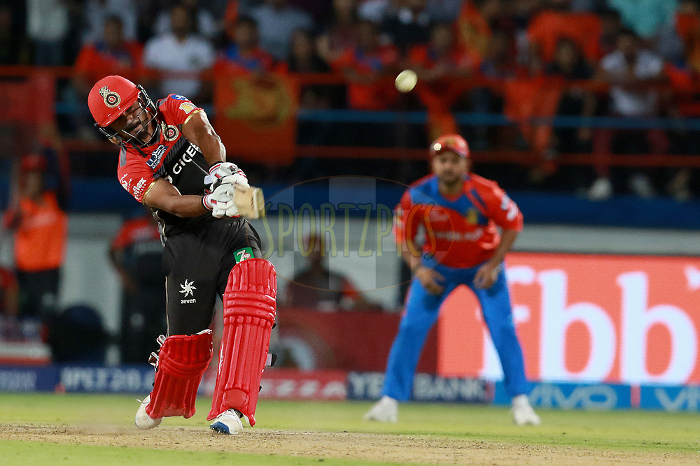 Kedar Jadhav of RCB plays a shot during match 20 of the Vivo 2017 Indian Premier League between the Gujarat Lions and the Royal Challengers Bangalore  held at the Saurashtra Cricket Association Stadium in Rajkot, India on the 18th April 2017<br /> <br /> Photo by Rahul Gulati - Sportzpics - IPL