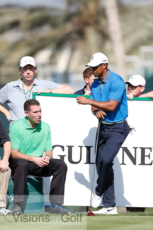 Tiger Woods with his manager Mark Steinberg<br /> Omega Dubai Desert Classic, Emirates GC, UAE, January 2014<br /> Picture Credit:  Mark Newcombe / www.visionsingolf.com