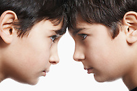 Twin boys (13-15) head to head close-up