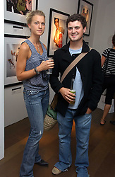 LADY ALEXANDRA GORDON-LENNOX and OLIVER LEWIS at an exhibition of photographs by David Montgomery entitled 'Shutterbug' held at Scream, 34 Bruton Street, London W1 on 13th July 2006.<br />