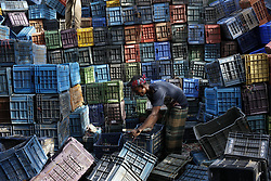 July 13, 2017 - Dhaka, Bangladesh - A day labor is working a plastic recycling factory in Dhaka. Plastic recycling is one of the growing businesses for Bangladesh worth $14 million dollars per years. (Credit Image: © Md. Mehedi Hasan via ZUMA Wire)