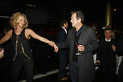Elle Macpherson and Mario Testino, MOVE FOR AIDS HOSTED BY ELLE MACPHERSON & DAVID FURNISH. Koko, Camden High St. London. 7/11/06. ONE TIME USE ONLY - DO NOT ARCHIVE  © Copyright Photograph by Dafydd Jones 66 Stockwell Park Rd. London SW9 0DA Tel 020 7733 0108 www.dafjones.com