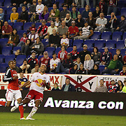 Thierry Henry, New York Red Bulls, scores as he lobs the Toronto goalkeeper Freddy Hall during his Man of the Match performance during the New York Red Bulls V Toronto FC  Major League Soccer regular season match at Red Bull Arena, Harrison. New Jersey. USA. 29th September 2012. Photo Tim Clayton