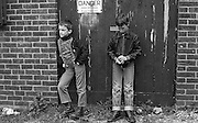 Boys Standing in front of Danger Sign, High Wycombe, UK, 1980s.