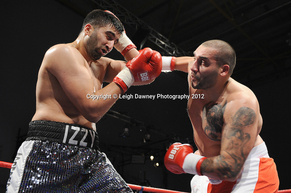 Issrar Asif (black/silver shorts) defeats Verban Borlsov in a Heavyweight contest on 3rd March 2012 at the Hillsborough Leisure Centre. Frank Maloney & Dennis Hobson Promotions © Leigh Dawney Photography 2012.