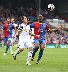 Swansea City's Angel Rangel vies for possession with Crystal Palace's Cameron Jerome  - Photo mandatory by-line: Robin White/JMP - Tel: Mobile: 07966 386802 22/09/2013 - SPORT - FOOTBALL - Selhurst Park - London - Crystal Palace V Swansea City - Barclays Premier League