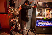 05 FEBRUARY 2005 - NOGALES, SONORA, MEXICO: A Nogales, Sonora, Mexico SWAT team sweeps a bar in Nogales during a drug interdiction sweep.  PHOTO BY JACK KURTZ