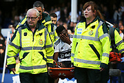 Fulham defender Timothy Fosu-Mensah (21) is carried off during the Premier League match between Everton and Fulham at Goodison Park, Liverpool, England on 29 September 2018.