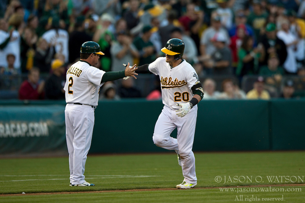 OAKLAND, CA - JULY 05:  Josh Donaldson #20 of the Oakland Athletics is congratulated by third base coach Mike Gallego #2 after hitting a home run against the Toronto Blue Jays during the third inning at O.co Coliseum on July 5, 2014 in Oakland, California. The Oakland Athletics defeated the Toronto Blue Jays 5-1.  (Photo by Jason O. Watson/Getty Images) *** Local Caption *** Josh Donaldson; Mike Gallego