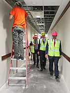 GSA Regional Administrator Jason Klumb (from left) and Cedar Rapids Mayor Ron Corbett walk down the hallway as work continues during a tour of the new Federal Courthouse in Cedar Rapids on Tuesday morning, April 10, 2012. (Stephen Mally/Freelance)