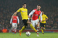 Henrikh Mkhitaryan of Borussia Dortmund shields the ball from Aaron Ramsey of Arsenal during the UEFA Champions League match at the Emirates Stadium, London<br /> Picture by Richard Calver/Focus Images Ltd +447792 981244<br /> 26/11/2014