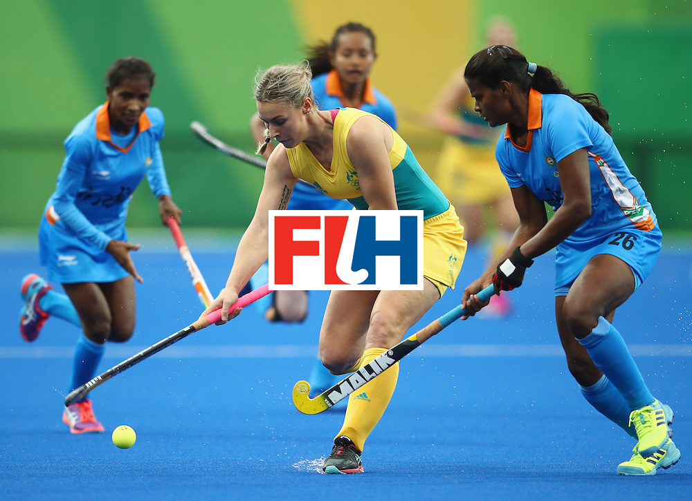 RIO DE JANEIRO, BRAZIL - AUGUST 10:  Mariah Williams of Australia is challenged by Sunita Lakra of India during the Women's Pool B Match between India and Australia on Day 5 of the Rio 2016 Olympic Games at the Olympic Hockey Centre on August 10, 2016 in Rio de Janeiro, Brazil.  (Photo by Mark Kolbe/Getty Images)