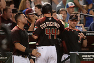 Aug 12, 2017; Phoenix, AZ, USA; Arizona Diamondbacks infielder Paul Goldschmidt (44) is congratulated by David Peralta (6) and manager Torey Lovullo (17) after scoring against the Chicago Cubs in the sixth inning at Chase Field. Mandatory Credit: Jennifer Stewart-USA TODAY Sports