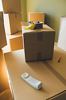Still life of boxes, tape dispenser and phone&#xA;<br />