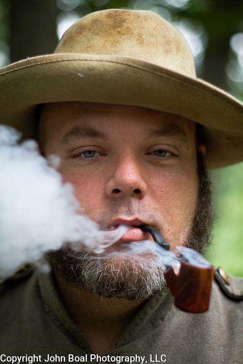 Charles Gerhart, of Clarksburg, West Virginia, civil war reenactor at the Confederate living history encampment, during the Sesquicentennial Anniversary of the Battle of Gettysburg, Pennsylvania on Wednesday, July 3, 2013.  The Battle of Gettysburg lasted from July 1-3, 1863 resulting in over 50,000 soldiers killed, wounded or missing.  John Boal Photography