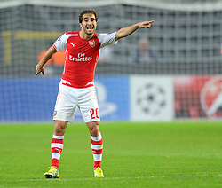 Arsenal's Mathieu Flamini points instructions to his team mates - Photo mandatory by-line: Dougie Allward/JMP - Mobile: 07966 386802 - 22/10/2014 - SPORT - Football - Anderlecht - Constant Vanden Stockstadion - R.S.C. Anderlecht v Arsenal - UEFA Champions League - Group D