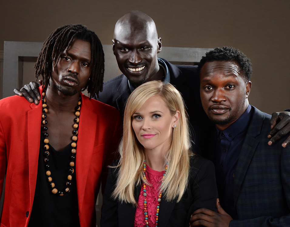 "9/17/14 2:47:35 PM -- Washington, DC, U.S.A  -- Reese Witherspoon poses with Emmanuel Jal, left, Ger Duany and Arnold Oceng.  They star in the movie ""The Good Lie,"" in which Witherspoon plays an American woman who takes in four Sudanese refugees when they win a lottery for relocation to the U.S.  Photo by H. Darr Beiser, USA TODAY staff ORG XMIT:  HB 131714 Reese Witherspoo 09/1 [Via MerlinFTP Drop]"