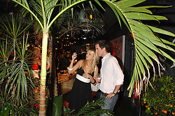HANNAH SANDLING and OLIVER FELSTEAD at the launch of the Desigual flagship store at 222 Regent Street, London W1 on 28th June 2007.<br />