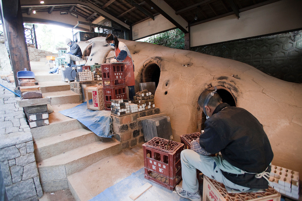 Nakazato Taroemon kiln (3-6-29 Machida, Karatsu; +81-955-72-8171), located a five minute walk from the train station. The 14th successor--in an unbroken lineage--plies his trade here along with a large staff of over twenty. Situated within a Japanese bonsai garden, the time-honoured spot also features a small shop connected to a museum by a simple wooden bridge.kiln being prepared