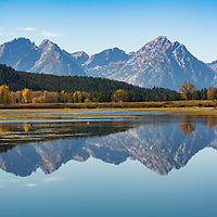 Reflections of mountains in still water, Grand Teton