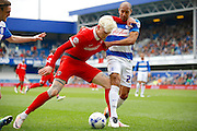 Charlton Athletic Striker Zakarya Bergdich (19) hplds off Queens Park Rangers midfielder Karl Henry (20) during the Sky Bet Championship match between Queens Park Rangers and Charlton Athletic at the Loftus Road Stadium, London, England on 9 April 2016. Photo by Andy Walter.