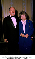 SIR ERIC & LADY PARKER, at a dinner in London on November 19th 1996.LTN21