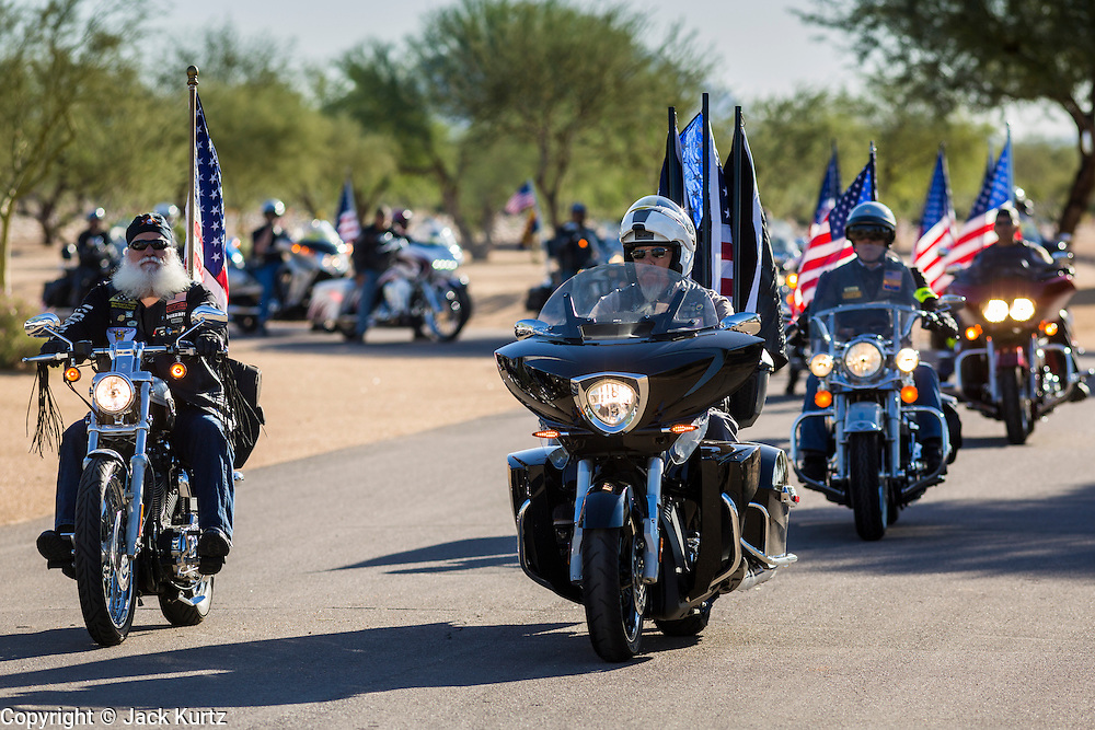 08 OCTOBER 2013 - PHOENIX, AZ:  The Patriot Guard Riders accompany the cremated remains of unclaimed US military veterans at the National Memorial Cemetery in Phoenix. The cremated remains of 36 unclaimed US military veterans were interred at the National Memorial Cemetery in Phoenix. Members of the US military and several hundred veterans of the US military attended the service, which was a part of the Missing In America Project (MIAP).   PHOTO BY JACK KURTZ